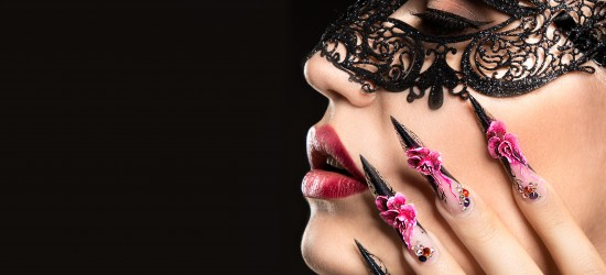 Beautiful girl with long nails and sensual lips. Portrait shot in the studio on a black background.Beauty face.